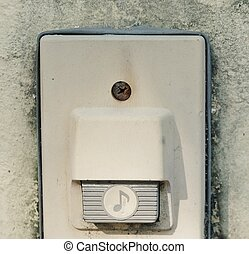 Eletronic Old Doorbell on The Concrete Wall