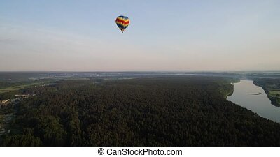 air baloon over green lands - air baloon flying over green...