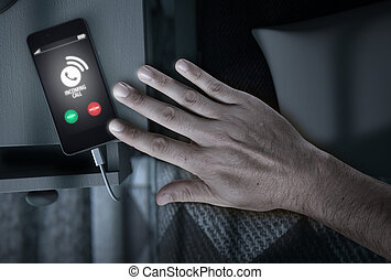 Incoming Call Cellphone Next To Bed - A night time scene of...