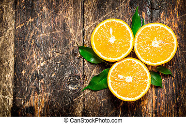 Fresh oranges with green leaves.