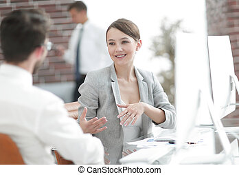 business woman talking with a business partner in the office