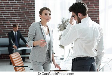 business meeting business women with a business partner in...
