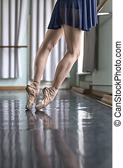 Legs of dancer in ballet hall - Gracile legs of a ballet...