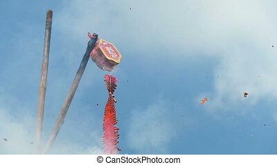 Red firecracker explodes against blue sky. Full HD 1080p...