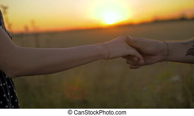 Close up of two Lovers Joining Hands.. Detail Silhouette of...