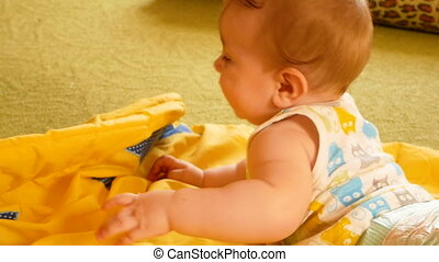 baby playing at home - Seven month old baby baby lies and...