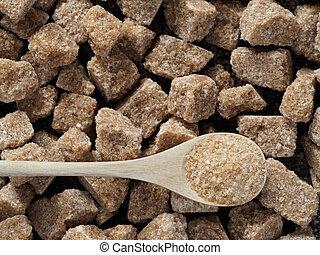 Rushy raw sugar cubes close up - natural raw brown cane...