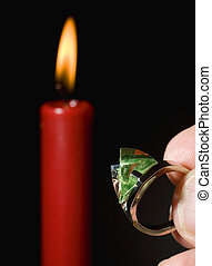 candlelit ring - peridot gemstone ring being presented under...