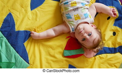 Small Baby Playing - Seven month old baby baby lies and...