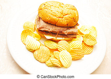 Steak & Cheese Sandwich on an Onion Roll with Vegetable Chips