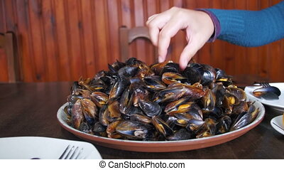 Seafood Mussels on a Plate In a Restaurant. Eating seafood...