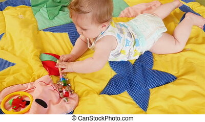 Small Baby Playing - Seven month old baby Playing on colored...