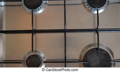 Gas stove in home. - Fire of a gas home furnace. The fire...