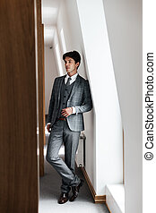 Full length of a confident businessman in suit posing