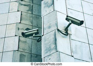 Big brother concept with two security cameras on the wall
