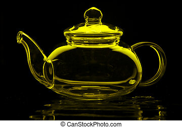 Green Tea - Glass teapot in lime green isolated on black