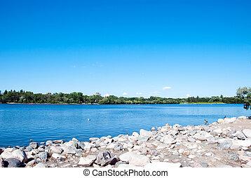 Wascana Lake - A lakeshore of Wascana Lake in Regina,...