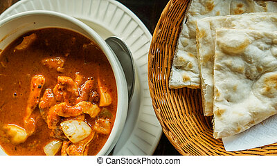 Indian cuisine red curry and nan bread - Indian cuisine red...