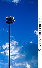 light pole of floodlight on evening dusk sky background -...