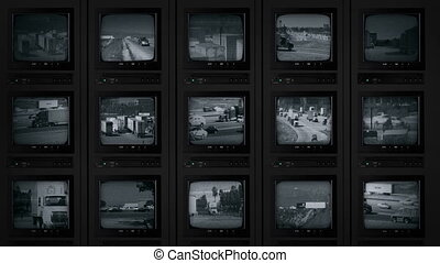 CCTV Screens Showing Busy Roads - Bank of CCTV monitors...