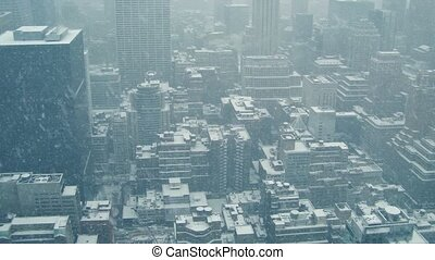 City Buildings From Above In Snowfall - Wide view of...