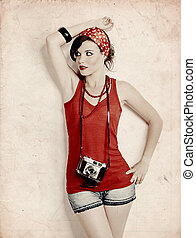Pin-up girl with a camera - Portrait of a beautiful and...