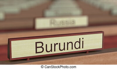 Burundi name sign among different countries plaques at international organization. 3D rendering