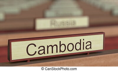 Cambodia name sign among different countries plaques at international organization. 3D rendering