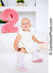 two year old birthday - Cute two year old girl playing at...