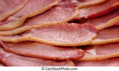 Cooked Bacon Turning Slowly - Delicious bacon platter...
