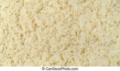 Cooked Rice Rotating - Overhead shot of cooked white rice...