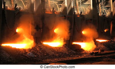 Furnace at the metallurgical plant - The metal is melted in...