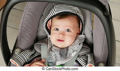 baby boy swinging in the car seat