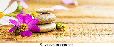 Spa still life with flowers and massage stones
