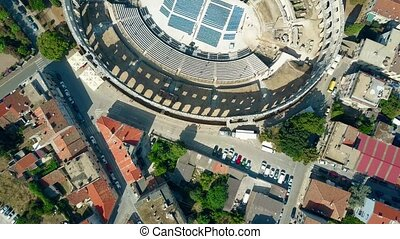 Aerial top down view of Pula city and ancient Roman...