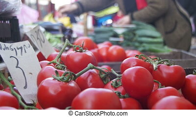 Showcase with Tomatoes and Vegetables in the Grocery Market....
