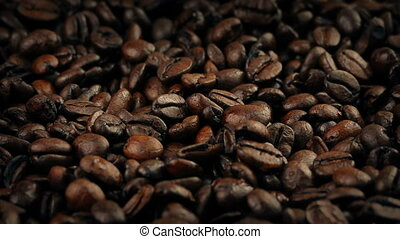 Delicious Coffee Beans Rotating Macro Shot - Closeup shot of...