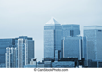 London financial district image with brands removed and image given blue tone to represent cold side of business and finance