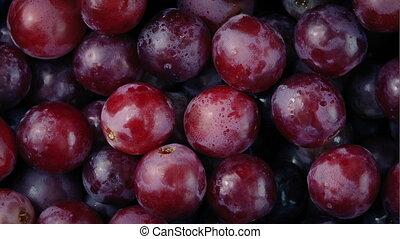 Delicious Red Grapes Rotating Closeup - Macro shot of...