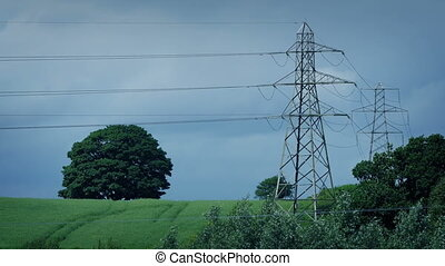 Electricity Pylons In Windy Countryside - Large electricity...