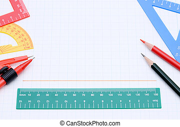 colorful rulers, pen and notebook on white background