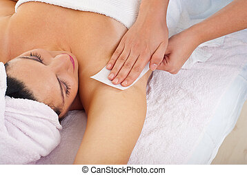 Waxing woman armpit - Close up of woman getting waxing...