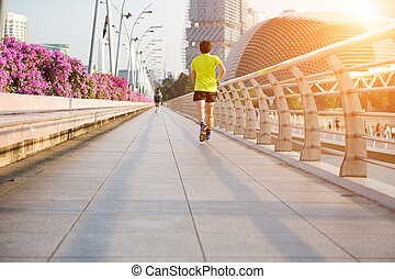 Young man is jogging on road. exercise concept.