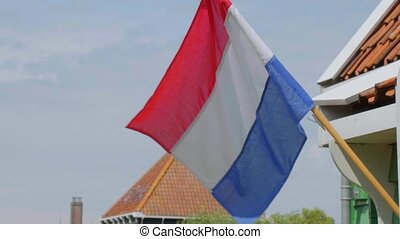 The flag of the Netherlands waving in the wind