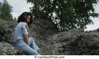 Beautiful woman on landscape looking away - Side view of...