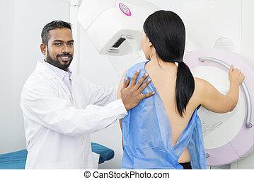Confident Doctor Assisting Woman Undergoing Mammogram Test -...