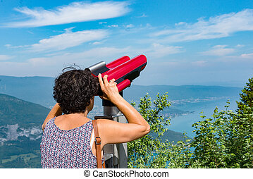 woman admires Lake Annecy at the Col de la Forclaz - A woman...