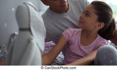 Cute little girl talking with her caring father - Close...