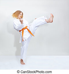 Blow leg girl is training with an orange belt