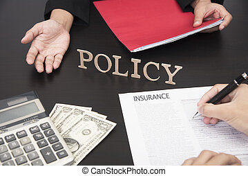 hand sign contract life insurance policy with agent.